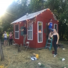 Ten Chances Artist Residents, painting the shanty!