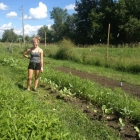 Ellie tending vegetables